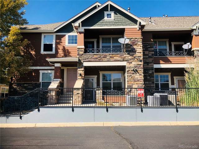 7130 Simms Street #101, Arvada, CO 80004 (#5533453) :: The Healey Group