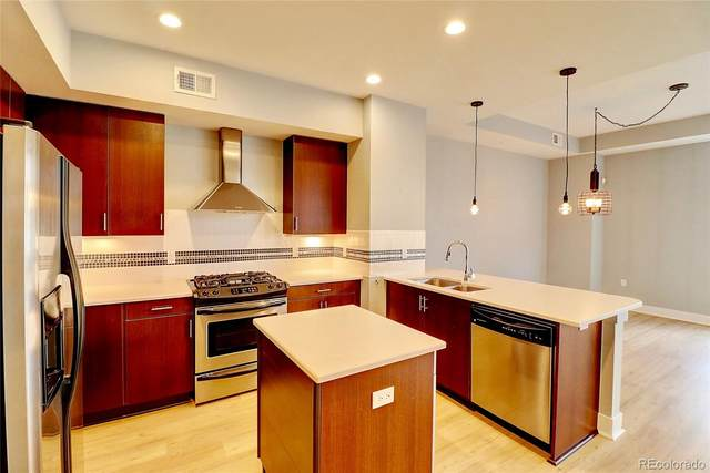 1488 Madison Street #102, Denver, CO 80206 (#5581955) :: The Griffith Home Team