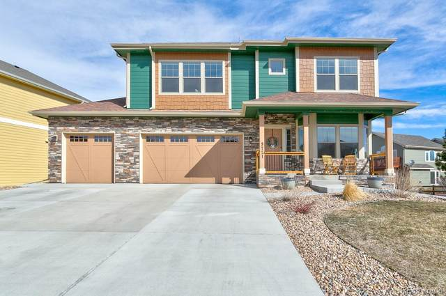 9721 S Crystal Lake Drive, Littleton, CO 80125 (#5615546) :: The HomeSmiths Team - Keller Williams