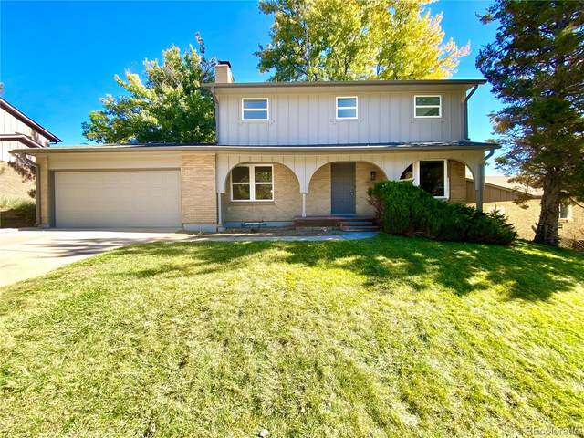 2438 S Holland Court, Lakewood, CO 80227 (#5616373) :: The DeGrood Team