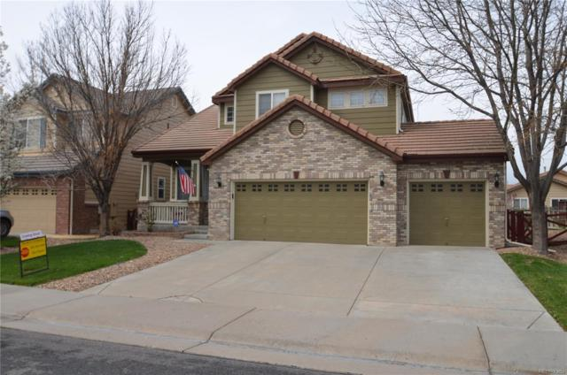 15135 E 117th Drive, Commerce City, CO 80603 (#5636604) :: The Healey Group
