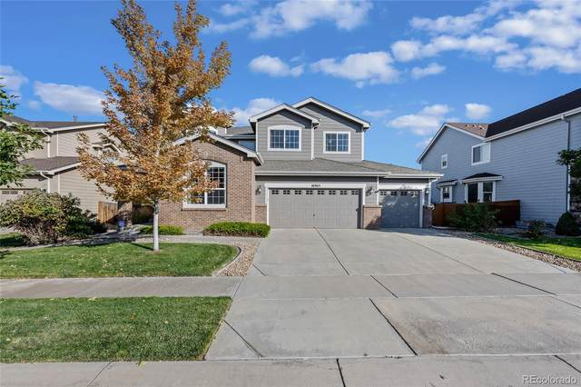 16365 E 107th Place, Commerce City, CO 80022 (#5650562) :: The DeGrood Team