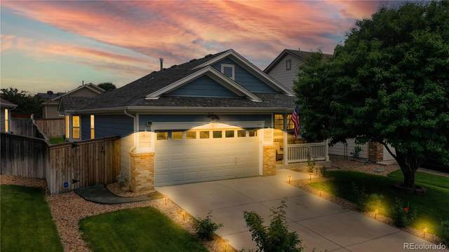 16128 E 105th Way, Commerce City, CO 80022 (#5660567) :: The Gilbert Group