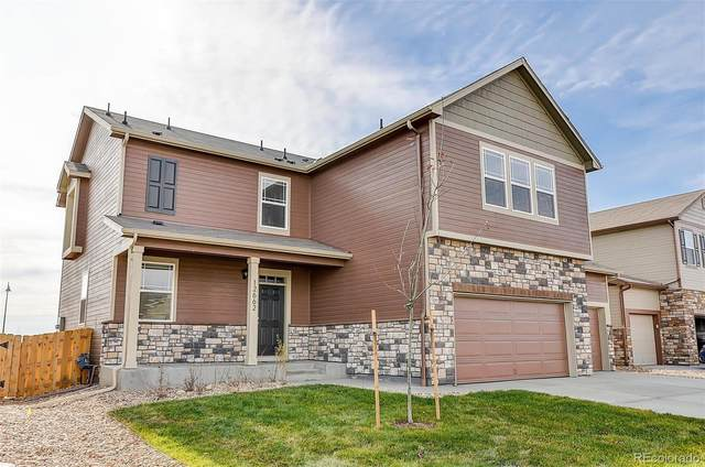 6087 N Halifax Court, Aurora, CO 80019 (#5675395) :: iHomes Colorado