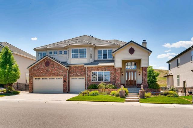 10402 Carriage Club Drive, Lone Tree, CO 80124 (#5730438) :: Group 46:10 - Denver