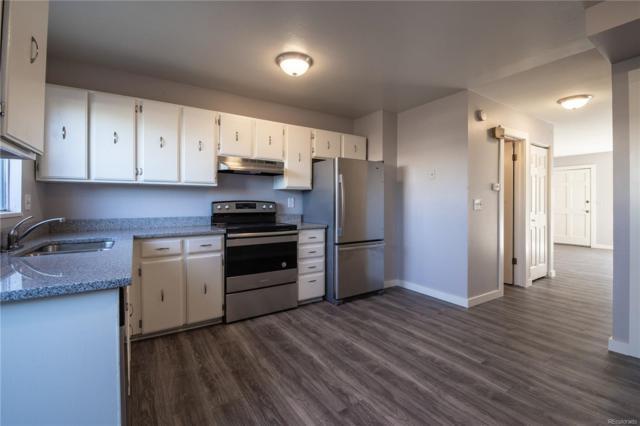 15777 E 13th Place, Aurora, CO 80011 (#5852336) :: Wisdom Real Estate