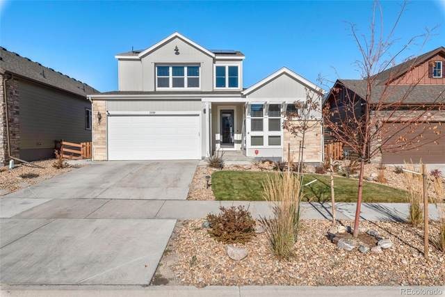 18789 W 92nd Drive, Arvada, CO 80007 (#5874340) :: The Dixon Group