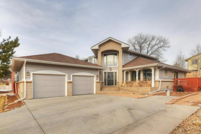 7502 Routt Lane, Arvada, CO 80005 (#5876249) :: The Peak Properties Group