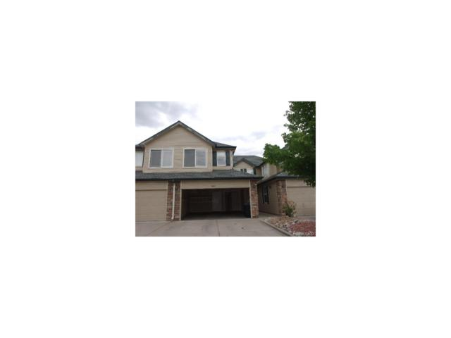 9221 W Chatfield Place, Littleton, CO 80128 (#5888043) :: The Griffith Home Team