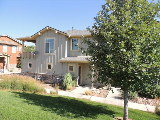 18060 E 104th Place A, Commerce City, CO 80022 (#5909927) :: My Home Team