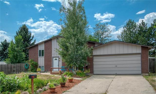 12478 W 70th Place, Arvada, CO 80004 (#5940391) :: The DeGrood Team