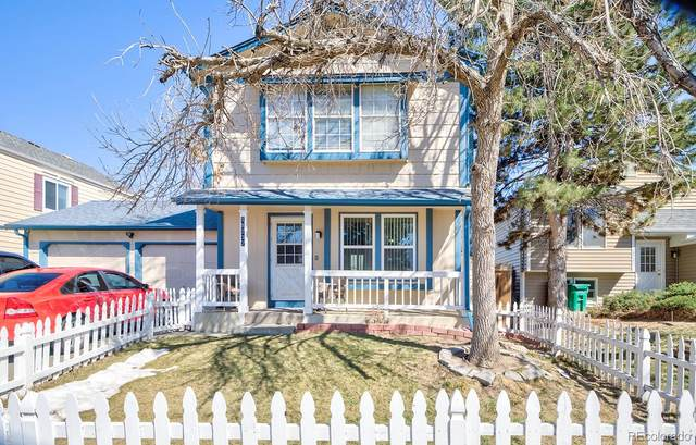 18737 E Carmel Circle, Aurora, CO 80011 (#5997509) :: Bring Home Denver with Keller Williams Downtown Realty LLC