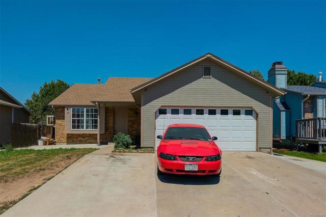 14565 Andrews Drive, Denver, CO 80239 (#6000340) :: Bring Home Denver
