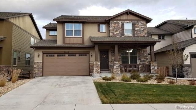 8662 Yule Street, Arvada, CO 80007 (#6014449) :: The Brokerage Group