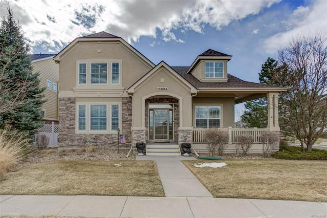 13884 W 86th Drive, Arvada, CO 80005 (#6023954) :: The Pete Cook Home Group
