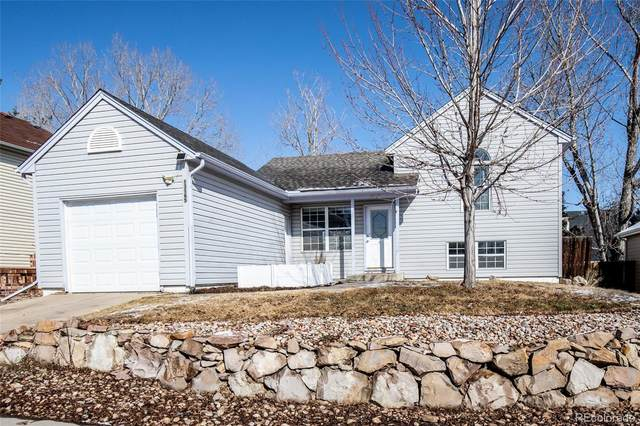 13165 W 63rd Circle, Arvada, CO 80004 (#6028794) :: The Dixon Group