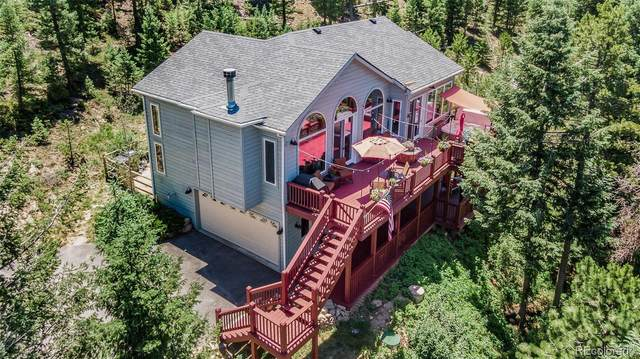 4571 SW Summit Trail, Evergreen, CO 80439 (#6073393) :: The Harling Team @ Homesmart Realty Group