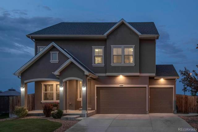 13595 E 107th Place, Commerce City, CO 80022 (#6121532) :: The Margolis Team