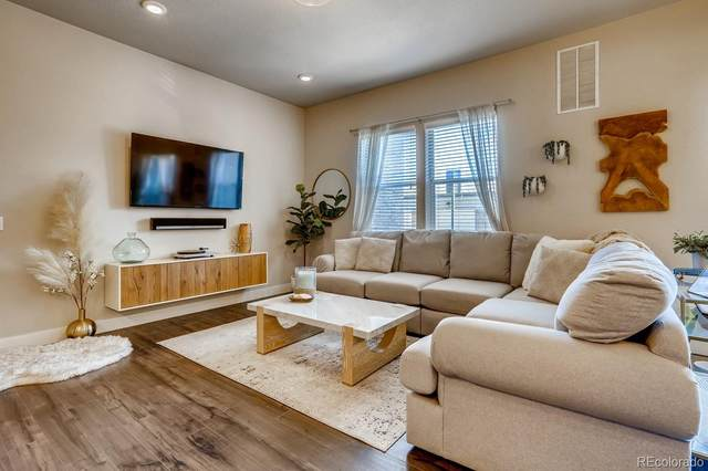 15345 W 64th Lane #102, Arvada, CO 80007 (MLS #6149557) :: Bliss Realty Group
