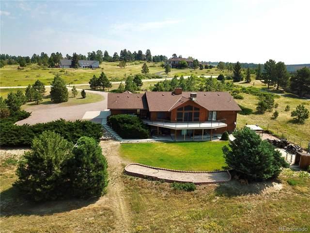 9880 E Bayou Hills Lane, Parker, CO 80134 (#6177848) :: iHomes Colorado