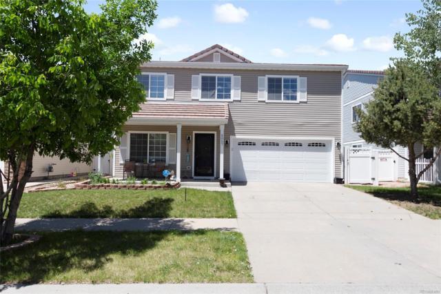 5057 Orleans Court, Denver, CO 80249 (#6205738) :: The Peak Properties Group
