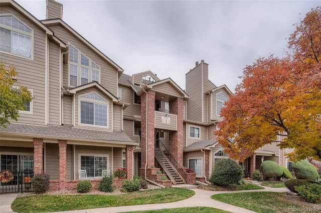 4760 S Wadsworth Boulevard J203, Denver, CO 80123 (#6238024) :: iHomes Colorado