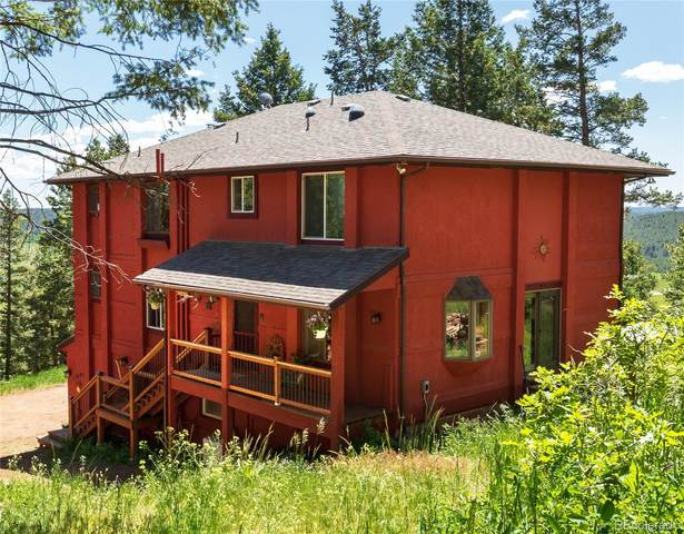 13694 Woodmoor West Drive, Larkspur, CO 80118 (#6256686) :: The Griffith Home Team