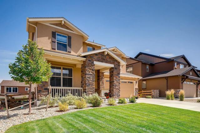 8682 Yule Street, Arvada, CO 80007 (#6265875) :: The Peak Properties Group