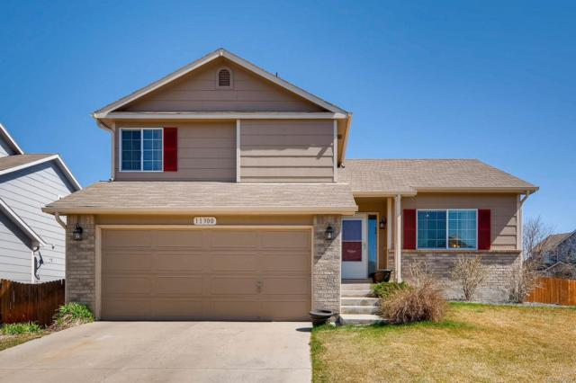 11300 Iola Street, Commerce City, CO 80640 (#6291667) :: The Peak Properties Group