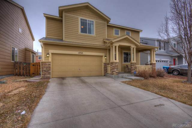 12763 E 105th Place, Commerce City, CO 80022 (#6342900) :: The Peak Properties Group