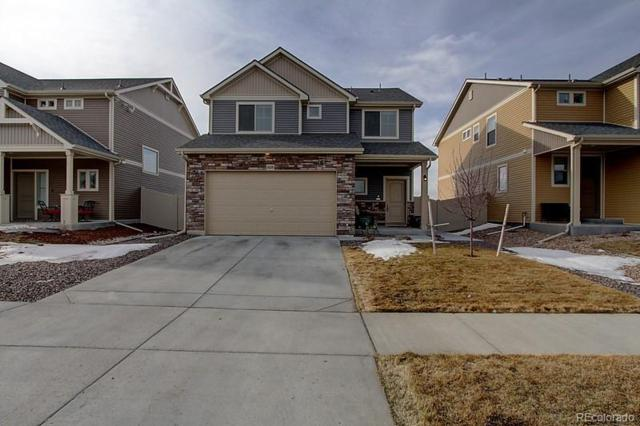 18228 E 52nd Avenue, Denver, CO 80249 (#6382795) :: My Home Team