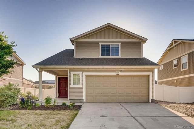 5571 Nepal Street, Denver, CO 80249 (#6426127) :: Portenga Properties