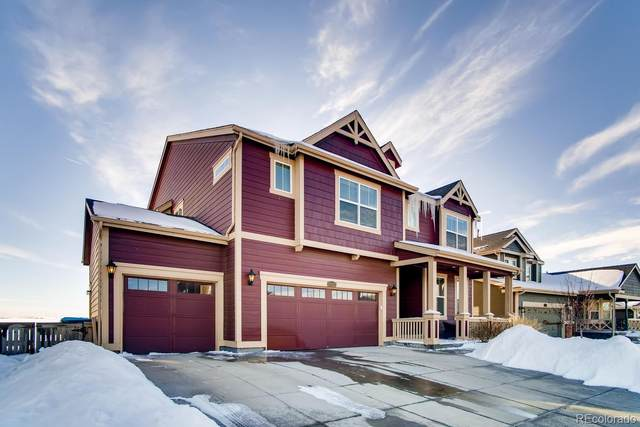 17332 E 98th Way, Commerce City, CO 80022 (#6443829) :: The Peak Properties Group