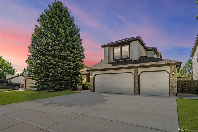 9036 W Chatfield Drive, Littleton, CO 80128 (#6571479) :: The Peak Properties Group