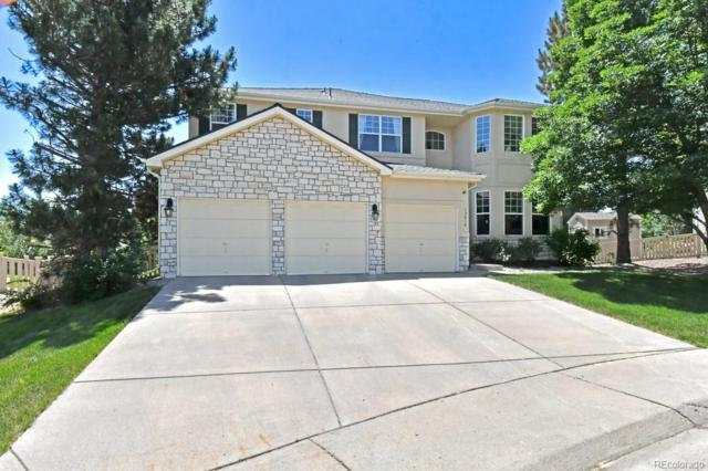 13614 W 63rd Circle, Arvada, CO 80004 (#6623899) :: Bring Home Denver