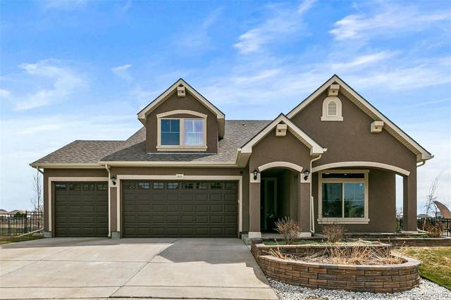 5111 Liverpool Way, Denver, CO 80249 (#6640206) :: The Griffith Home Team