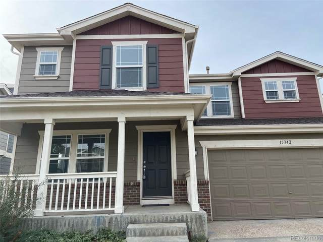 15342 E 100th Court, Commerce City, CO 80022 (#6659712) :: The Griffith Home Team