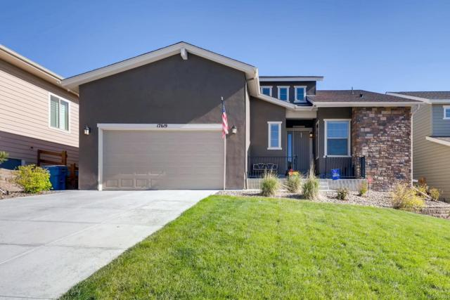 17619 W 94th Drive, Arvada, CO 80007 (#6699439) :: The HomeSmiths Team - Keller Williams