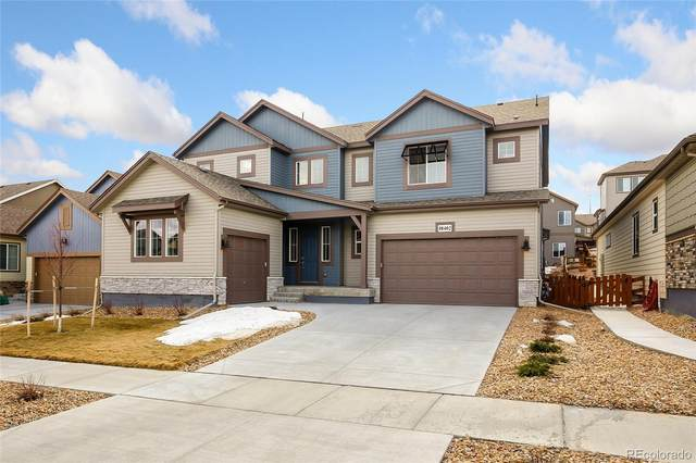 18402 W 93rd Place, Arvada, CO 80007 (#6745646) :: The Brokerage Group