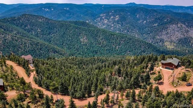13071 Deer Ridge Way, Larkspur, CO 80118 (#6845604) :: Symbio Denver