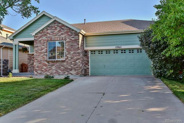13962 E 104th Place, Commerce City, CO 80022 (#6854568) :: You 1st Realty
