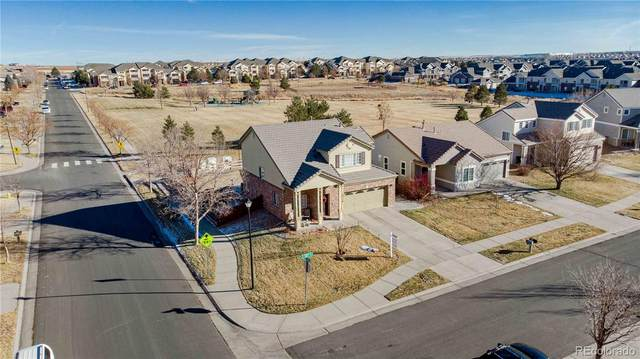 19558 E 58th Circle, Aurora, CO 80019 (#6862336) :: The Dixon Group