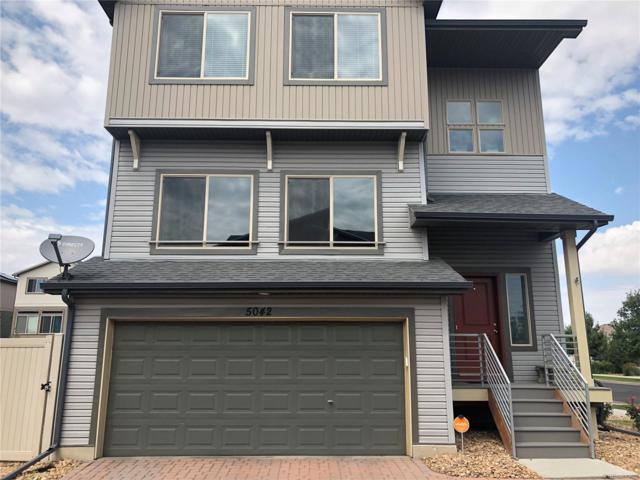 5042 Andes Way, Denver, CO 80249 (#6870810) :: Ben Kinney Real Estate Team