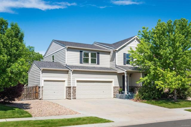 10049 Granby Drive, Commerce City, CO 80022 (#6871768) :: The Healey Group