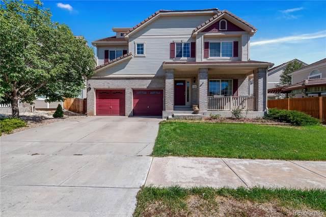 11826 Helena Street, Commerce City, CO 80022 (#6897399) :: Peak Properties Group