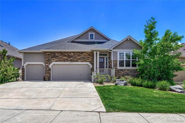 14042 W 87th Drive, Arvada, CO 80005 (#6897419) :: The Griffith Home Team