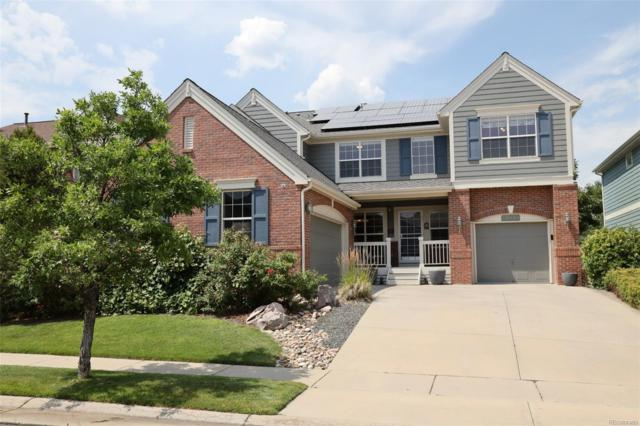 13461 W 85th Drive, Arvada, CO 80005 (#6899786) :: The Healey Group
