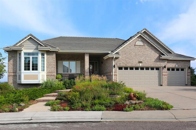 11704 W Auburn Drive, Lakewood, CO 80228 (#6912112) :: House Hunters Colorado