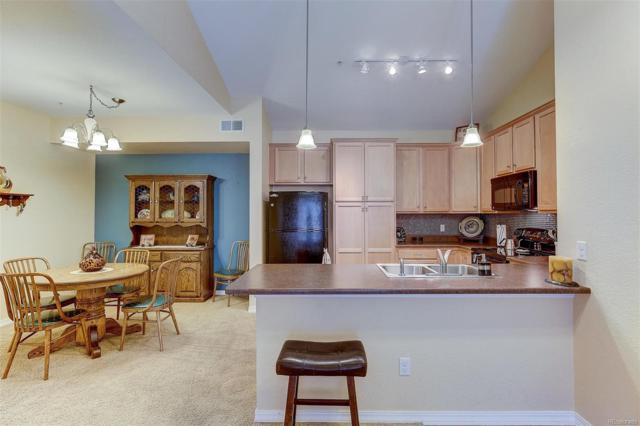 10061 W Victoria Place #208, Littleton, CO 80127 (#6928925) :: My Home Team