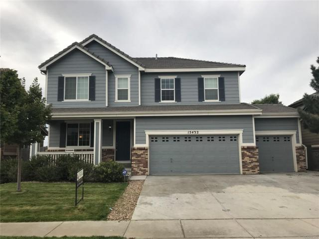 15432 E 117th Avenue, Commerce City, CO 80022 (#6967964) :: The City and Mountains Group